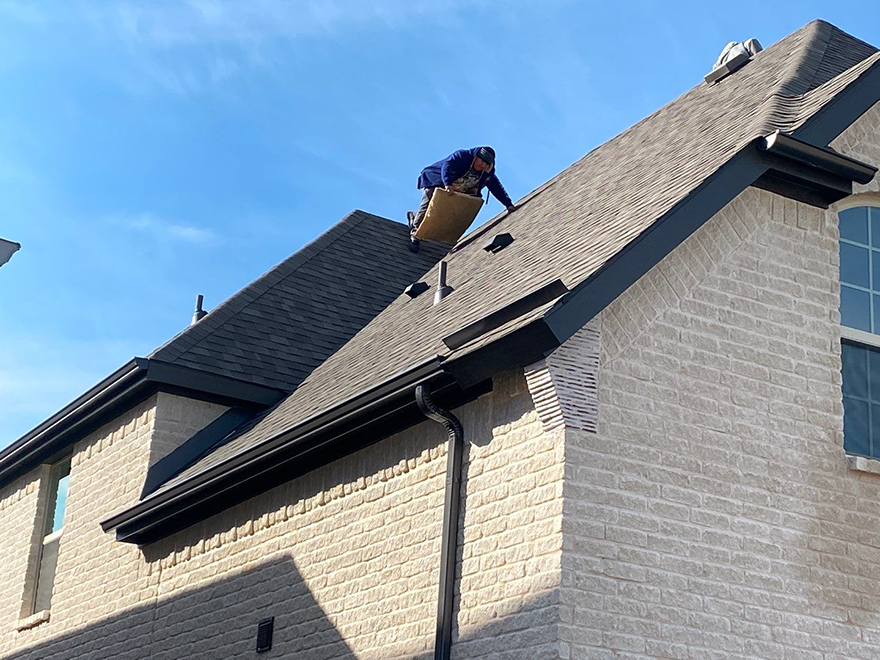 Roof contractor performing a roofing inspection in Frisco home
